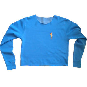 blue cropped sweatshirt with lightning bolt motif