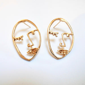 gold coloured face earrings