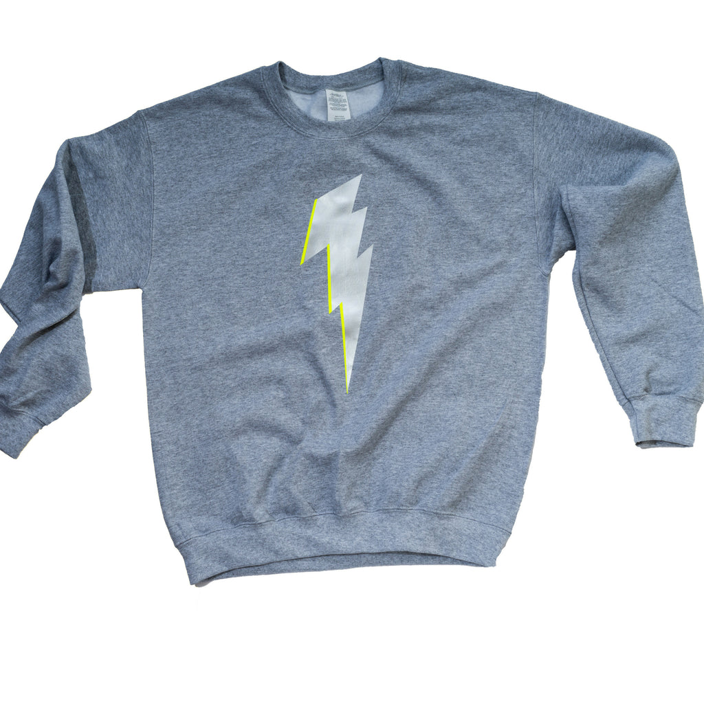 Grey sweatshirt with silver lightning bolt (yellow highlight)
