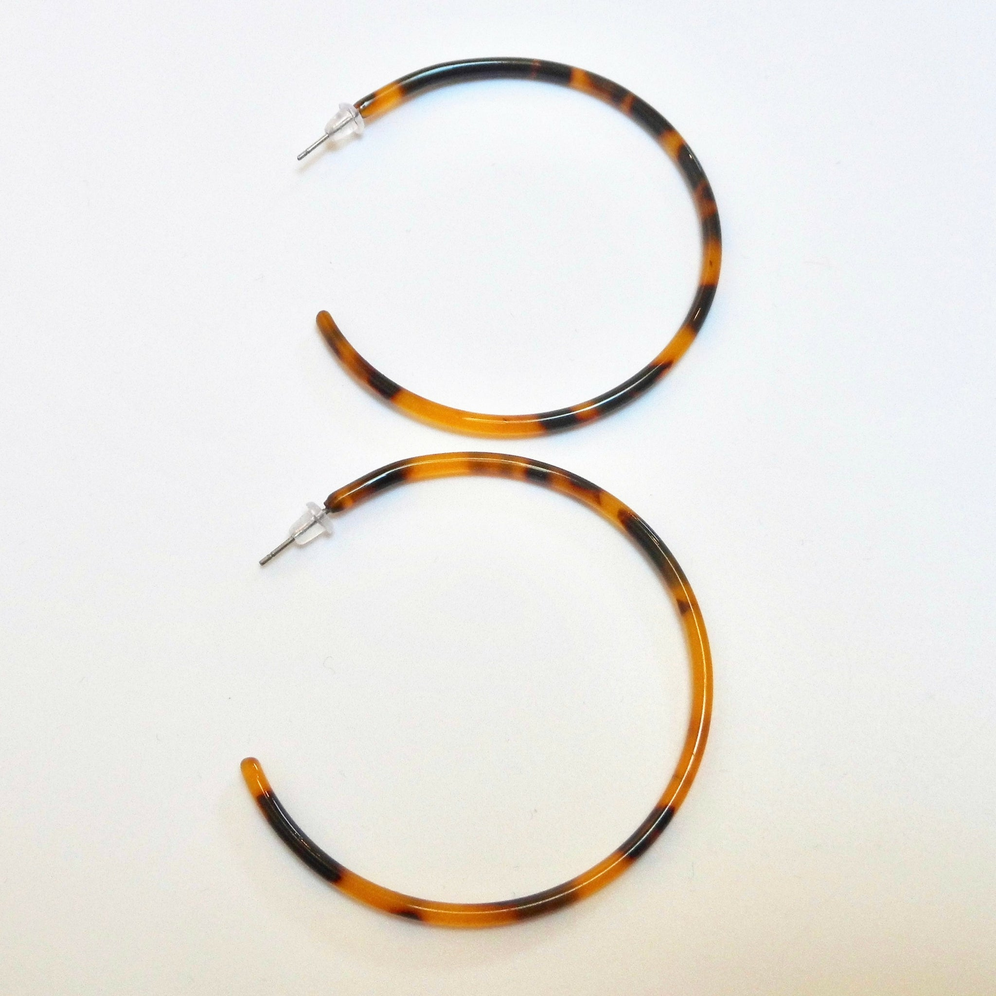 large skinny hoop earrings in tortoiseshell