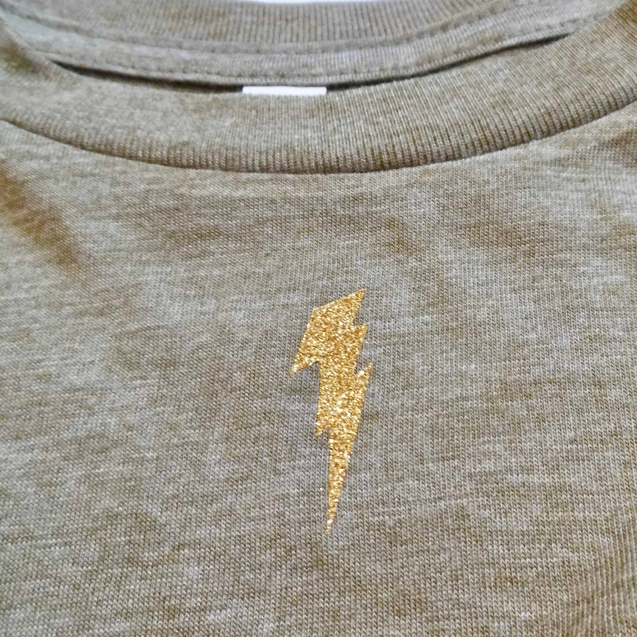 close up of gold lightning bolt