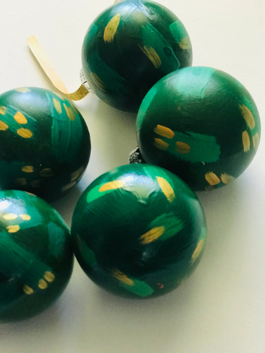 green + gold holiday bauble