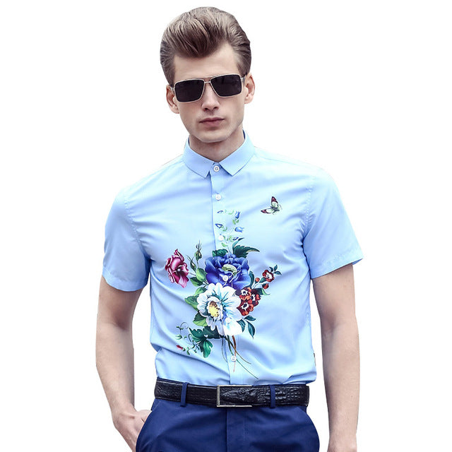 Light Blue Coloured short sleeve smart shirt with floral pattern.