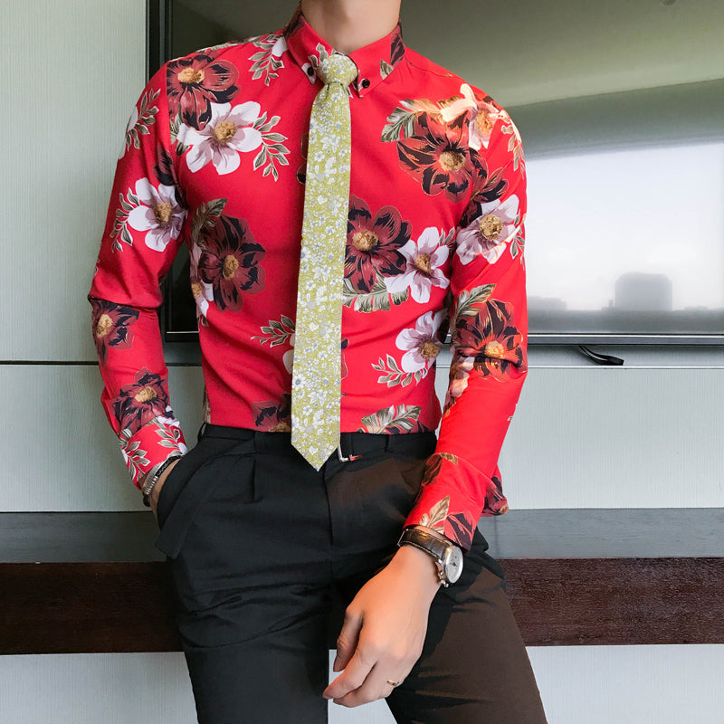 Multi coloured long sleeve flowery shirt with red background.