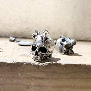 """Alo"" quartz skull necklace"