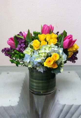 colorful flowers arranged in a vase