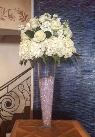 elevated arrangement of hydrangeas and roses