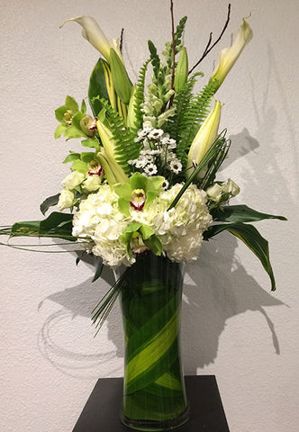 elevated arrangement of white and green blooms with orchids