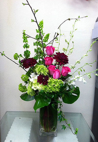 beautiful arrangement of seasonal flowers such as roses and hydrangeas