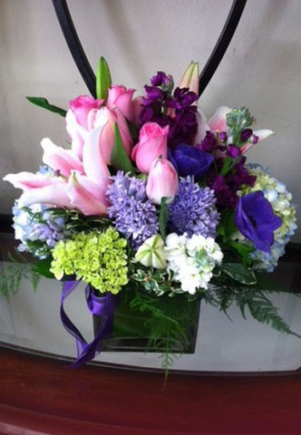 colorful arrangement of roses, lilies and hydrangeas