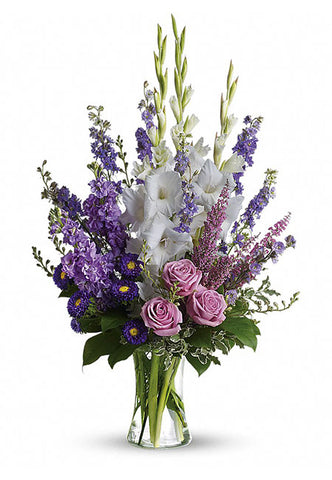 White and lavender sympathy flower bouquet in a vase