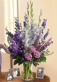 Sympathy vase arrangement with white and lavender flowers