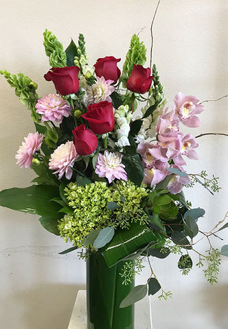 Tall arrangement of Orchids and Roses