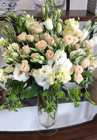 Premium arrangement of blush flowers such as roses and lisianthus