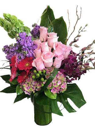 Tall arrangement of roses, bells of island, hydrangeas, roses and gerbera daisies