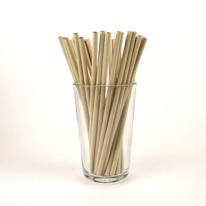 Unwrapped True Kraft Paper Straws in a Glass