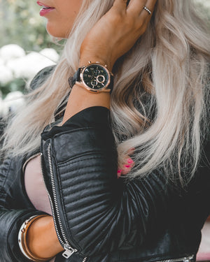 blonde women with black leather jacket and rose gold watch