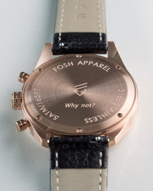 "Back of rose gold watch case with engraved logo reading ""why not"""