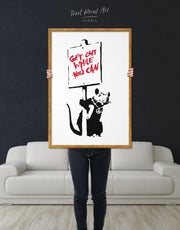Framed Get Out While You Can by Banksy Wall Art Canvas
