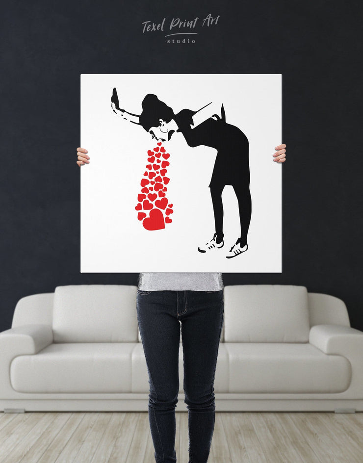 Girl Throwing Up Hearts by Banksy Wall Art Canvas Print - 1 panel Banksy banksy wall art Black black and white wall art