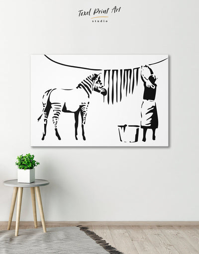 Washing Zebra Stripes by Banksy Wall Art Canvas Print - 1 panel banksy Banksy wall art black black and white wall art