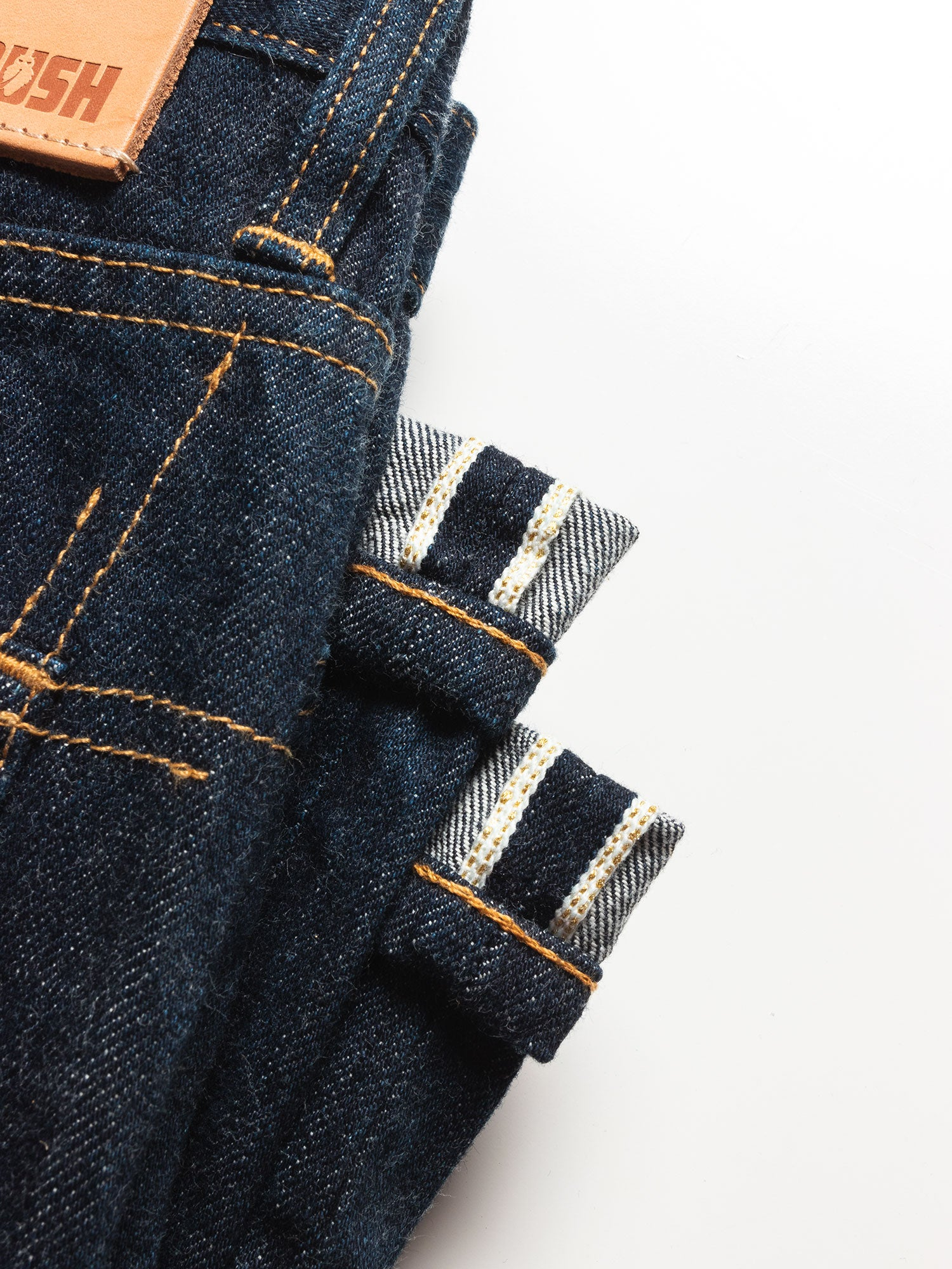 An up close image of the gold selvedge detail on the jeans.