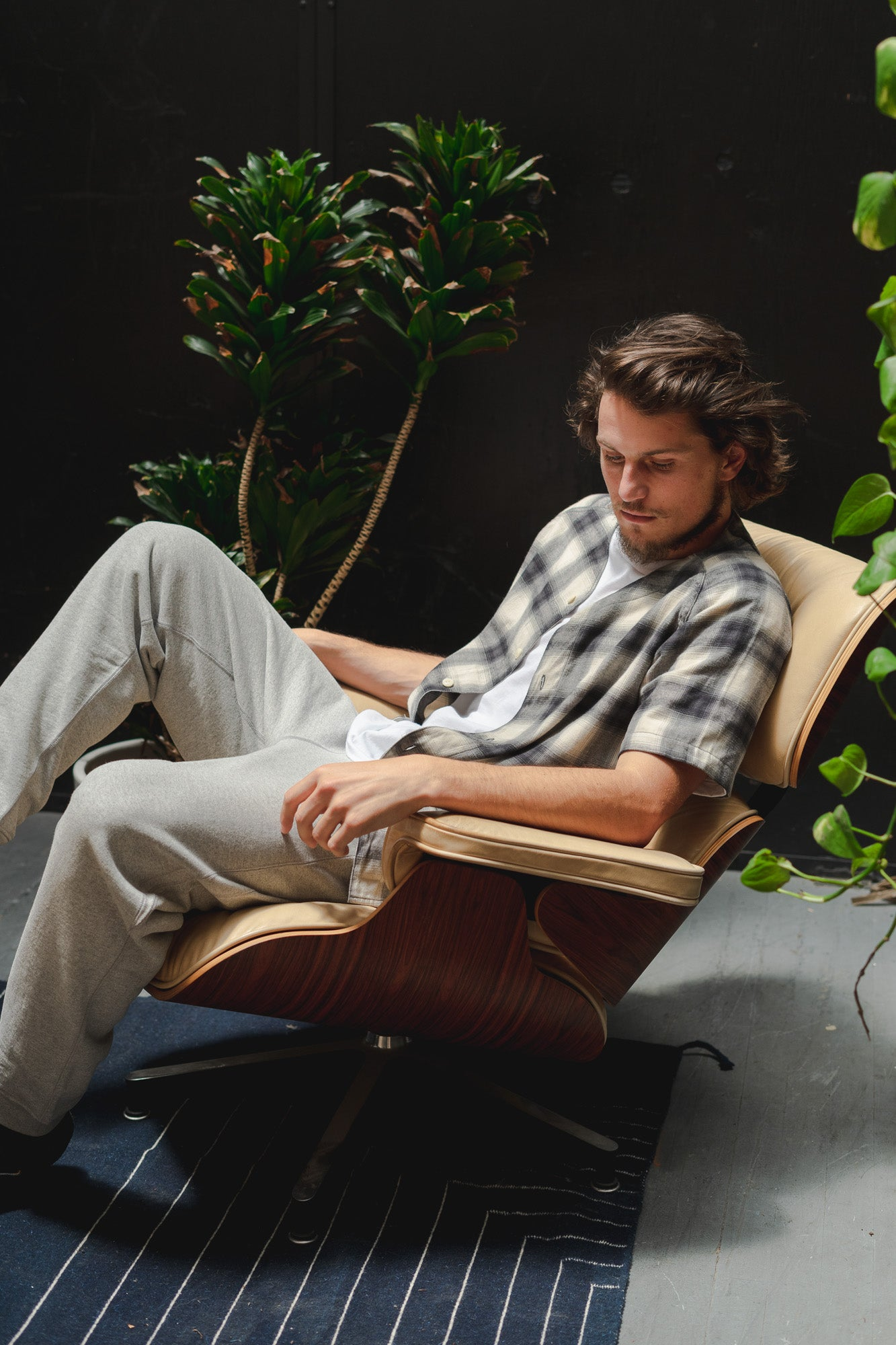 A man in a lounge chair leans back.