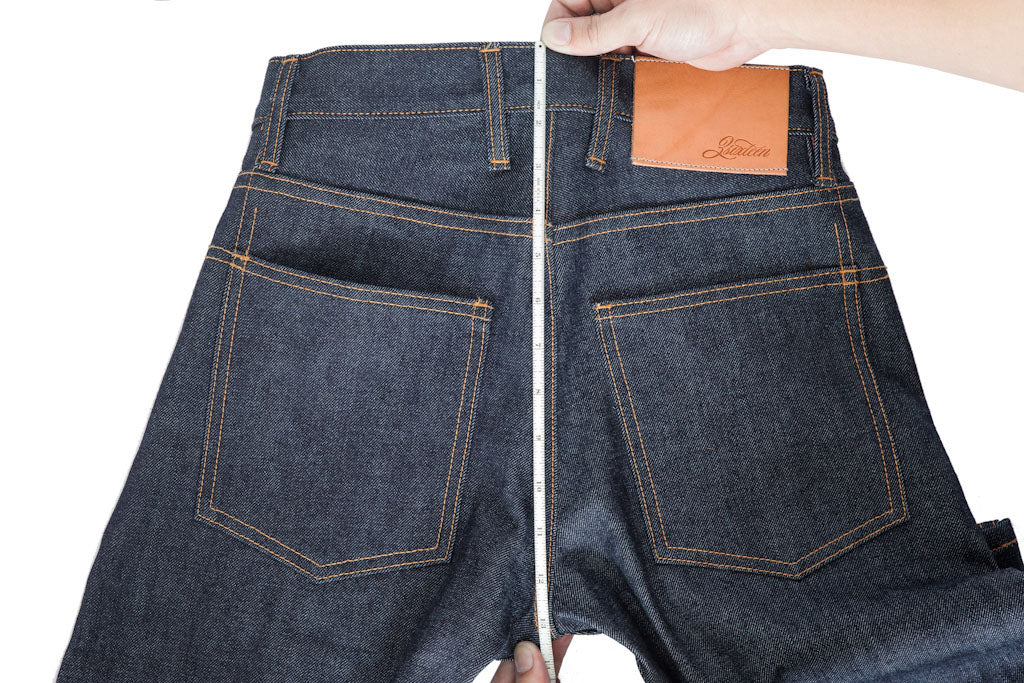 A tape measure runs down the backside of a jean from waistband to back crotch.