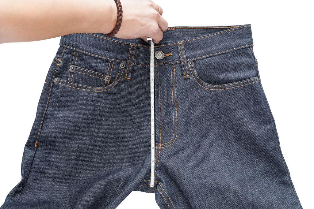 A tape measure runs down the front of a jean from waistband to front crotch