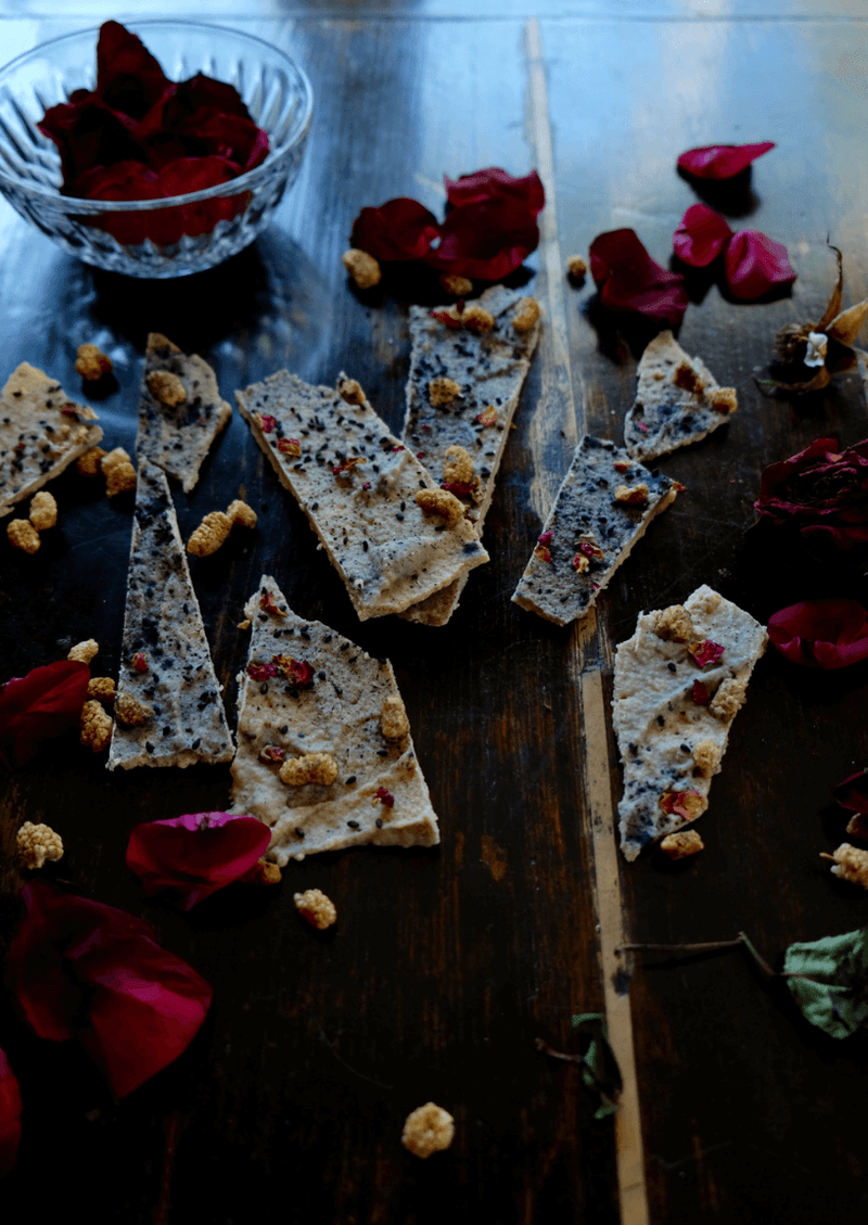 bark with bite: raw floral infused white chocolate charcoal bark