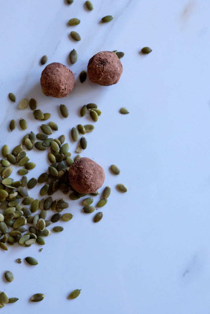 balancing raw cacao and pumpkin seed truffles for women