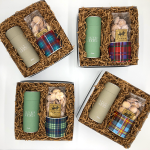 Each gift comes with one of four tartan mug designs. Includes: Choice of Jasmine Green or White Peony Tea, Tartan Mug and Leila's Lemon Snaps.