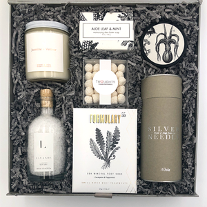 Unwind gift includes: Formulary 55 Sea Salt and Lavender Shea Butter hand cream, Formulary 55 Peppermint Foot Soak,  Lavender Bath Salts, Jasmine and Vetiver Candle, Aloe Leaf and Mint Bath soap, Champagne Bubbles candy and Silver Needle Tea.