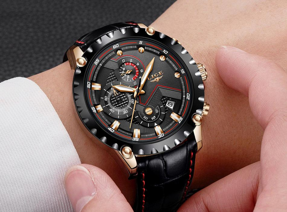 a black watch on a persons hand