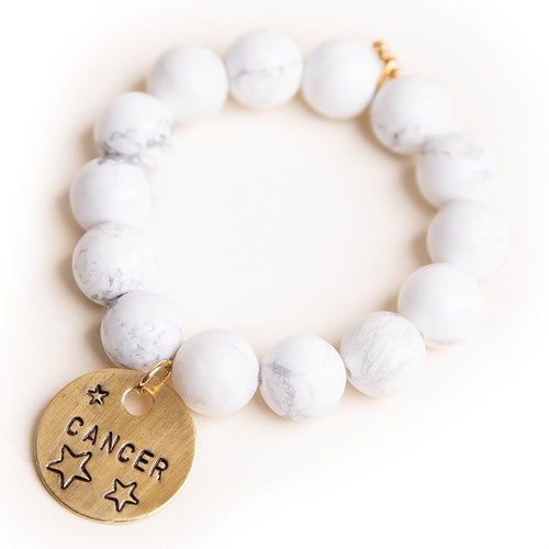 Bright white howlite paired with a bronze hand stamped Cancer medal