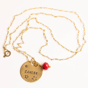 Clear quartz rosary chain necklace with red agate accent and hand stamped bronze Cancer medal