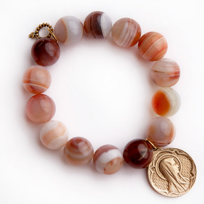 Sanibel agate paired with a brass Blessed Mother medal