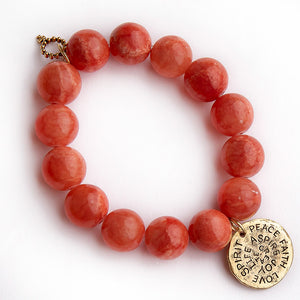 Terra cotta agate paired with a brass spirit medal