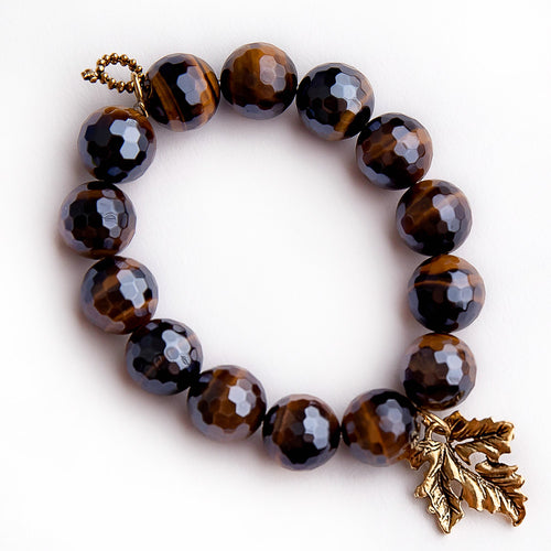 Faceted iridescent tiger eye paired with a brass Fall leaf