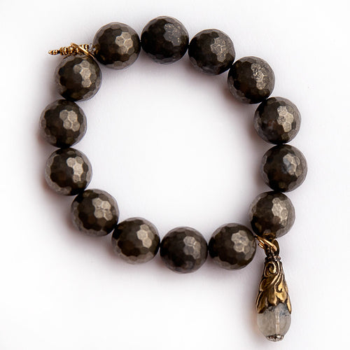 Faceted matte pyrite paired with a gemstone droplet