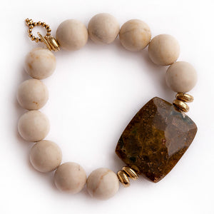 Cream Coral paired with coffee jasper statement slice and gold accents