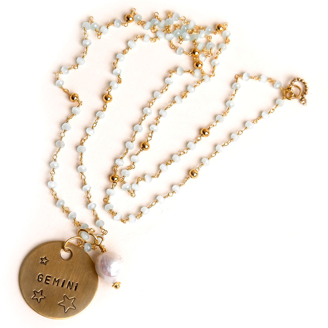 Aqua quartz rosary chain necklace with pearl accent and hand stand bronze Gemini medal