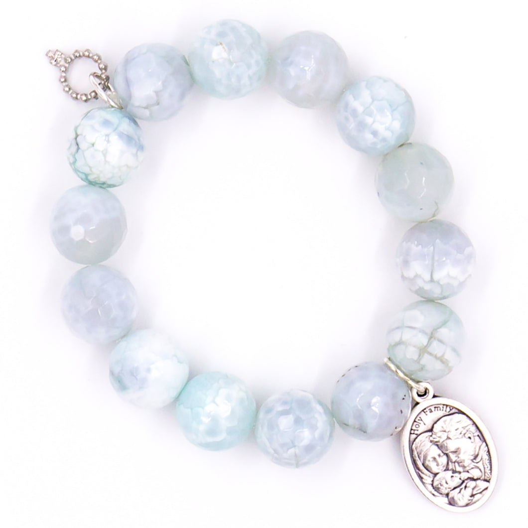 Faceted aquamarine agate with silver medal