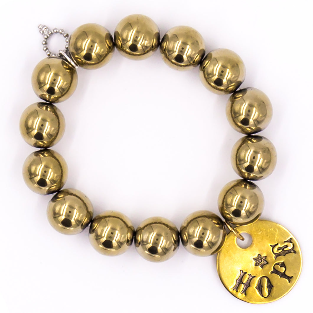 Gold hematite with brass hope medal