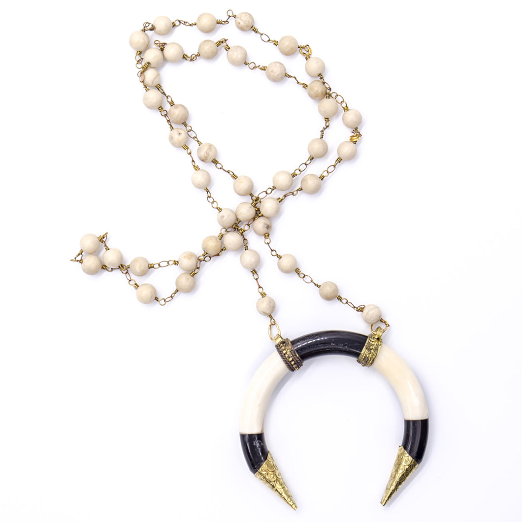 Cream coral with lucky horseshoe bone pendant