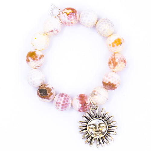 Honeycomb agate with silver sun medal