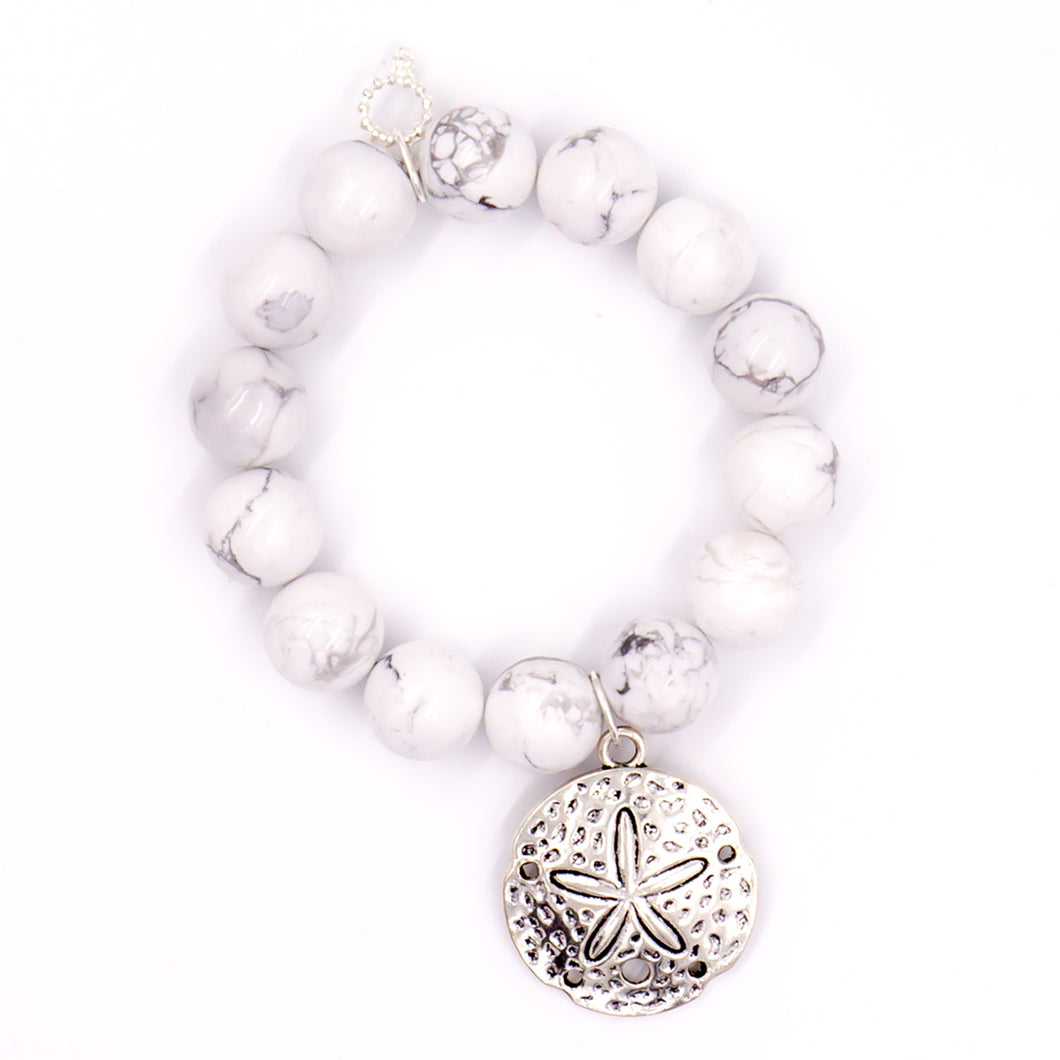 Bright white howlite with silver sand dollar medal