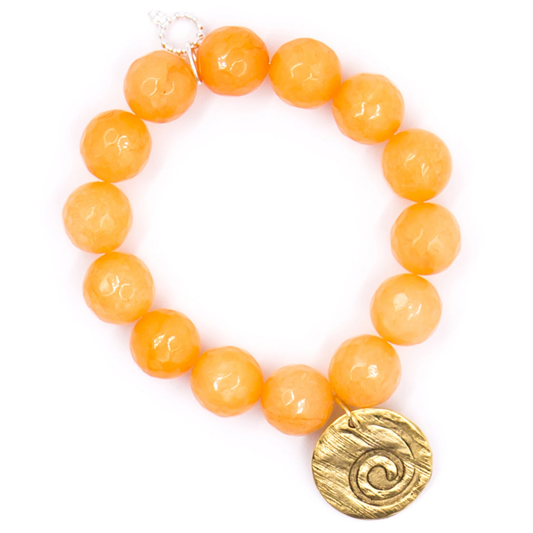 Tangerine faceted agate with brass wave medal
