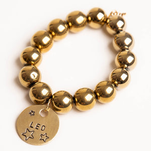Faceted gold hematite paired with a bronze hand stamped Leo medal