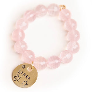 Faceted rose quartz paired with a bronze hand stamped Libra medal